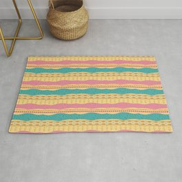 african ethnic yellow turquoise and pink pattern Rug