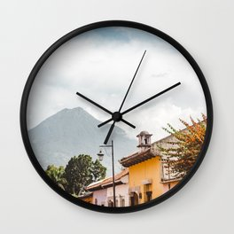 Colorful houses of a street in Antigua Guatemala with volcano views Wall Clock