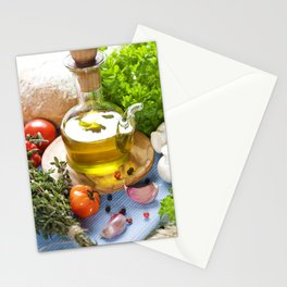 Bottle of Olive oil and condiments on blue napkin Stationery Cards