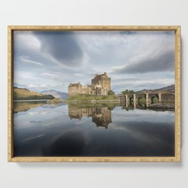 Eilean Donan castle with reflection in the water in Scotland Serving Tray