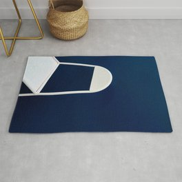 White chair on Blue background Rug