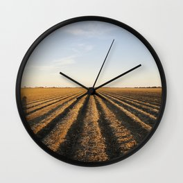 Plowed cotton fields on the outskirts of Clarksdale in Mississippis Delta region Wall Clock