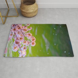 Beautiful Japanese Pink Cherry Blossom Over A colorful Green Garden Pond Petals Drifting Away Rug