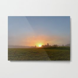Sunrise in the blue sky over a mown field in the morning misty haze Metal Print