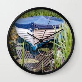 Moored row boat Wall Clock