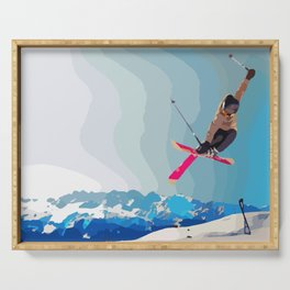 Man jumps with skies on piste with mountains and sky background Serving Tray