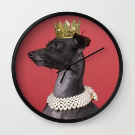 A brown Italian greyhound dog with a pearl collar and a gold crown against a red background Wall Clock