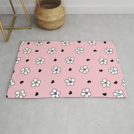 Cute Colorful daisy flower field pattern with black heart pink background Rug