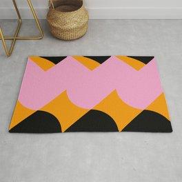 Vertical black and orange waves, in a pink sea, near three black orange mountains. Rug