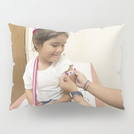 A doctor placing a bandage on the injection site of a child Pillow Sham