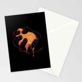 Hand Squeezes an Orange Stationery Cards