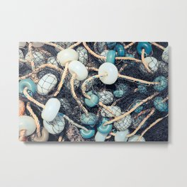 Mixed up fishnet with rope and lot of buoys Metal Print