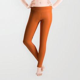 Black doodle paw prints with orange background Leggings