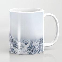Majestic mountains below clouds Coffee Mug
