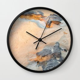 Rocks on beach, late afternoon Wall Clock