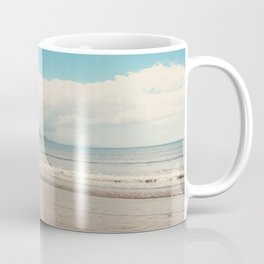 A row boat abandoned on the beach at Lyme Regis, England Coffee Mug