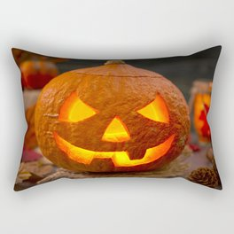 Burning Jack O'Lantern on a rustic table with autumn decorations Rectangular Pillow