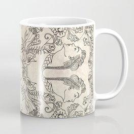 The Four Faces Coffee Mug