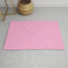 .Embossed roses on a pink background with decorative elements. Rug