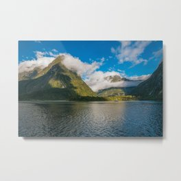 Spectacular mountain range surrounded by clouds close to sunset at Milford Sound Metal Print