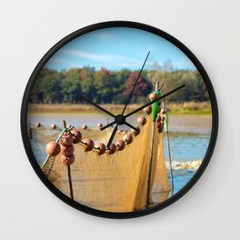 Large fishing net planted in middle of pond of Dombes Wall Clock
