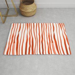 Vertical watercolor lines - orange Rug