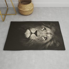 Beautiful monochrome lion face on dark background. Powerful calm and confident maned male lion. Rug