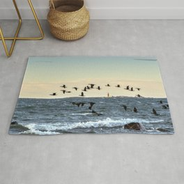 Flying flock of cormorants Rug