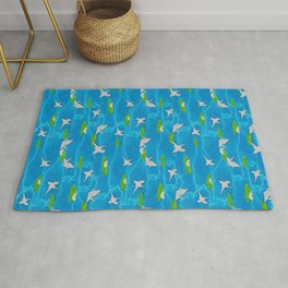 Paper cranes in a pond origami Rug