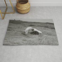 Girl Sleeps in an Open Field Rug