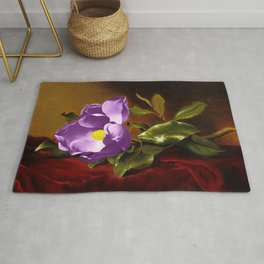 A Purple Magnolia on Red Velvet by Martin Johnson Head Rug