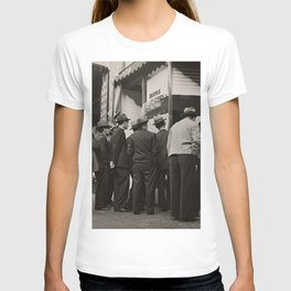 GRAYSCALE PHOTOGRAPHY OF MEN STANDING NEAR HOUSE T-shirt