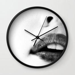 the unbearable kiss of a stranger Wall Clock