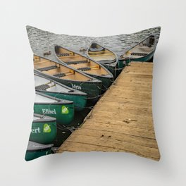 Kayaks and canoes moored to a wooden staging on Salhouse Broad Throw Pillow