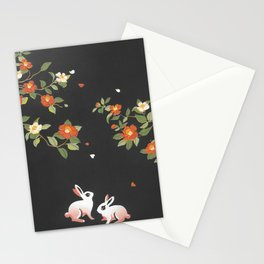 Rabbits in the garden of flowers Stationery Cards