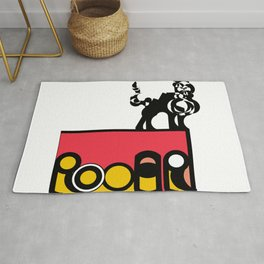 Roar in a Box (top right)- The word Roar within a box decorated in Pink and Yellow and a feline on top.  Rug
