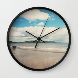 A row boat abandoned on the beach at Lyme Regis, England Wall Clock