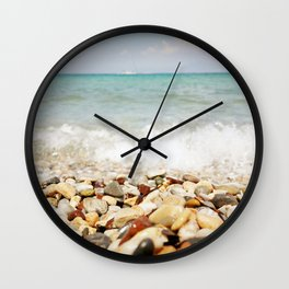 Little stones meet the sea Wall Clock