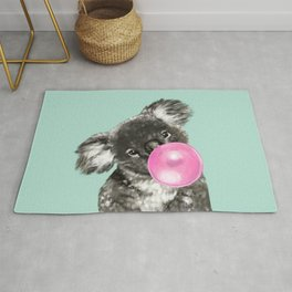 Playful Koala Bear with Bubble Gum in Green Rug