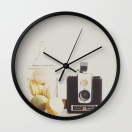 a vintage kodak brownie camera with delicious french macarons Wall Clock