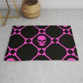 Skulls and bones hot pink on black Rug