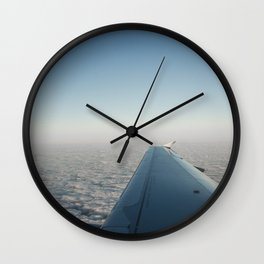 Wing in the clouds Wall Clock