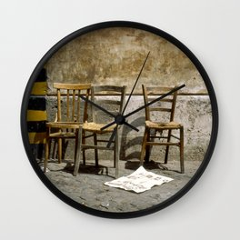 Three chairs and newspaper Wall Clock