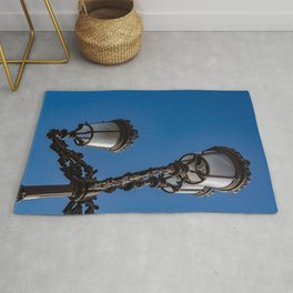Old iron lamp with three heads Rug