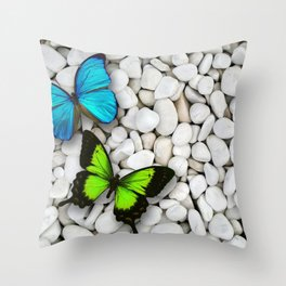 Blue & Green butterfly sitting on white stones Throw Pillow