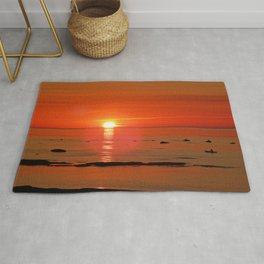 Kayaker and the Setting Sun Rug