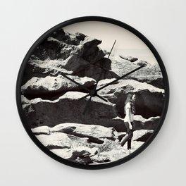Girl on Rocks Wall Clock