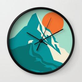 As the sun rises over the peak Wall Clock
