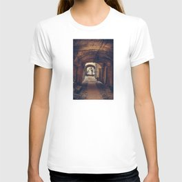 Silhouette of a man at the end of the tunnel in a medieval city T-shirt