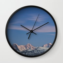 Last light on snowy mountain peaks. Wall Clock